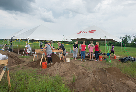 Tents are strategically placed at the Gehring Site on campus where the archaeological field school is hard at work uncovering history this summer.