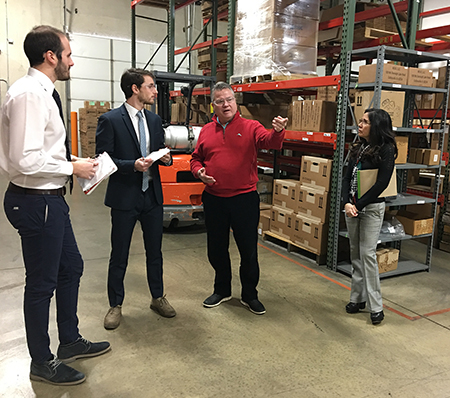(L-R) SIUE alumni Gabriele Fancelli and Pietro Beimer, of Italy, stand on site with International Trade Center at SIUE client Craig Eversmann, president and CEO of Marsh Shipping Supply Co, LLC, and ITC at SIUE Director Silvia Torres-Bowman.