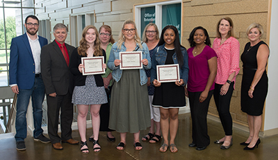 (L-R) SIUE Staff Senate Treasurer and Scholarship Chair Collin Van Meter, Chancellor Randy Pembrook, Maggie Haas, Stacey Haas, Taylor Hansen, Trish Hansen, Alexis Acoff, Fannie Acoff, Staff Senate President Gretchen Fricke, and SIU Board of Trustees Chair Amy Sholar.