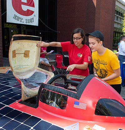 (L-R) Sophomore Jacqueline Corral shows sophomore Sara Simpson SIUE's Solar Car and encourages her to get involved.