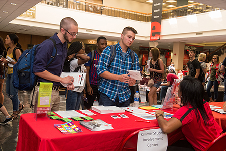 Capri Wroten, of Chicago, reacts happily to her newly created caricature during the SIUE Resource Fair. Nathan Cauley (left), of Bunker Hill, and Logan Siekmann, of Troy, visit with a representative from the Kimmel Student Involvement Center during the SIUE Resource Fair.