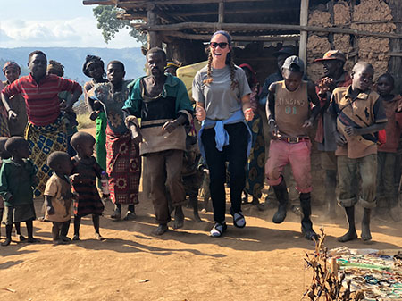 SIUE's Cheyenne Durham, of Swansea, joins dancers at the Batwa village students visited on Lake Bunyonyi during their travels study program in Uganda.
