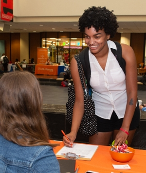 SIUE sophomore Mahdi Gourdine signs up to learn more about volunteer opportunities with the National Multiple Sclerosis Society.