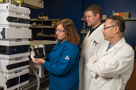 Graduate student Samantha Wilhelm works with equipment that has enhanced the research productivity of SIUE's Drs. Tucker (middle) and Lu (right).