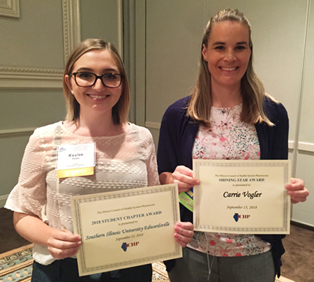 SIUE SSHP chapter president Kaylee Poole stands alongside Dr. Carrie Vogler during the ICHP annual meeting in Chicago. Poole accepted the 2018 Student Chapter Award and Vogler was presented the Shining Star Award.
