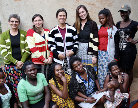 (back L-R) SIUE Dr. Kathryn Brady and speech language pathology students Katherine Wilson, Brianna Bowles and Sarah Geatley stand with women who work in a knitting workshop in Mukono, Uganda.