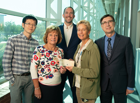 (L-R front) SIBA Chief Executive Officer Donna Richter presents a $20,000 check to SIUE's Anne Werner, PhD, associate professor and chair of the Department of Construction, and (L-R back) Assistant Professor Chenxi Yuan, PhD, Associate Dean Chris Gordon, PhD, and Dean Cem Karacal, PhD.