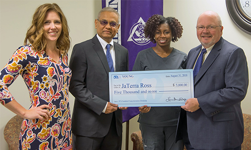 (L-R) SIU SDM Director of Community Dentistry Dr. Katie Kosten; Director of Operations with Young Dental Rajul Amin, representing the Dental Trades Alliance Foundation; scholarship recipient Jaterra Castine-Ross; and SIU SDM Dean Dr. Bruce Rotter.