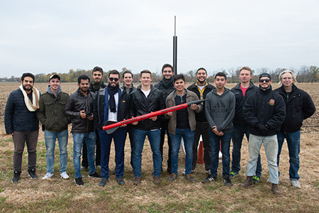 Charter members of SIUE's new Cougar Rockets organization, and their faculty advisor Michael Denn (far right) celebrate their first launch.