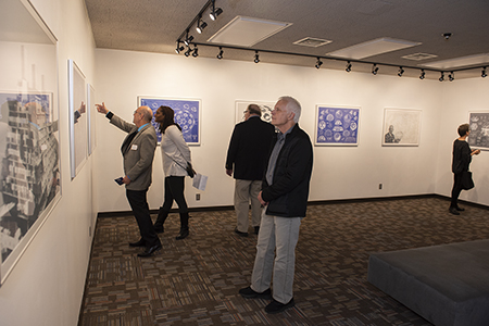 Attendees at the Fuller Dome Gallery opening enjoy the exhibition of R. Buckminster Fuller's art print portfolio entitled Inventions: Twelve Around One.