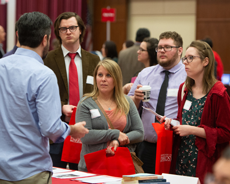 Dylan Anderson, Ami Murphy, David Thompson, and Autumn Haas listened intently to a history graduate program representative at the SIUE Graduate School Open House.
