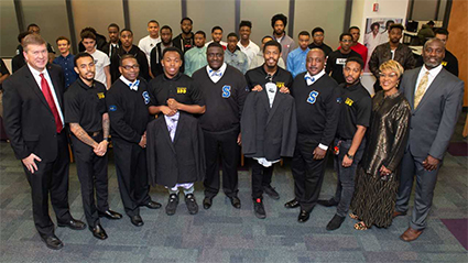 A representation of SIUE's Collegiate 100 Chapter and Goal-Oriented African American Men Excel (GAME) were at the Phi Beta Sigma Fraternity's presentation of business attire.