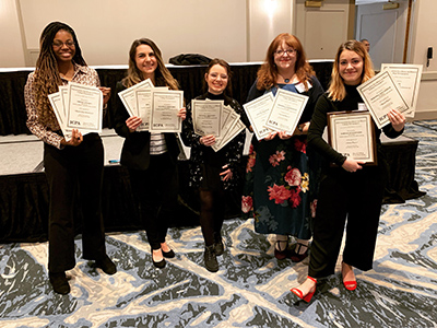 (L-R) JoAnn Weaver, Bridget Christner, Kait Baker, Tammy Merrett and Miranda Lintzenich hold The Alestle staff's collective IPCA awards.
