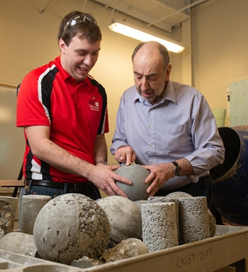 SIUE professor emeritus Luke Snell, PE, offers his concrete expertise to senior construction management major and SIUE ACI Student Chapter vice president David Rall.