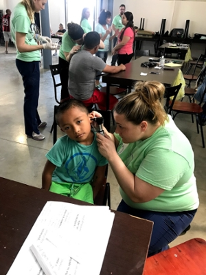 SON Student McDannald with Costa Rica patient.