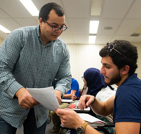 SIUE Visiting Fulbright Scholar Wajdi Balloumi, of Tunisia, works with an SIUE student.