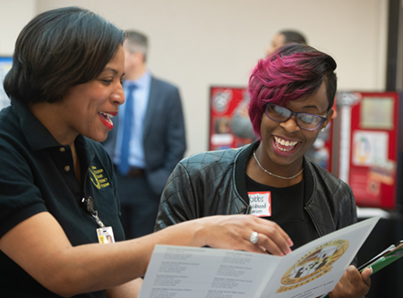 SIUE early childhood education major Jami Gibbs (R) smiles alongside Tracee Wells (L) while learning about the East St. Louis District 189 Urban Education Teacher Residence Program.