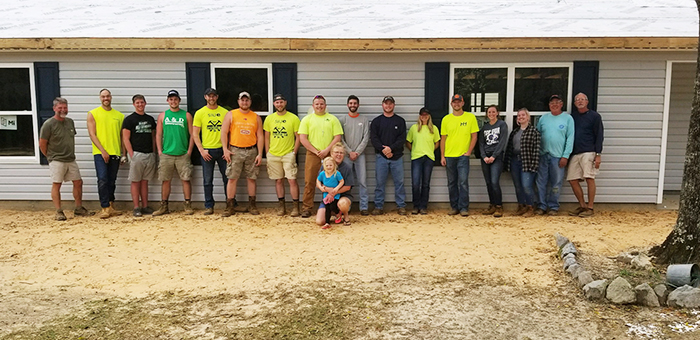 Members of the SIUE Constructor's Club volunteered their time building houses in Florida during the University's spring break. Pictured here are the SIUE volunteers, along with core volunteers from Habitat for Humanity and the homeowner.