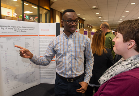 Previous RGGS award recipient Chiagozie Obuekwe presents his research that benefitted from the funding.