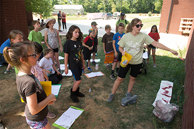 Super Sleuths at Odyssey Science Camp learn about collecting evidence during an outdoor camp session.