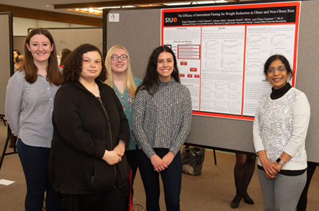 Dr. Chaya Gopalan (right) stands with members of her research team, including (L-R) Hannah Ruholl, Alyssa Allen, Paige Niepoetter and Coral Viemow.