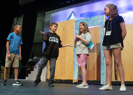 (L-R) Mark Hill, Charlie Houle, Nora Cummins and Sydney Andrews practice a scene from Frozen, Jr.