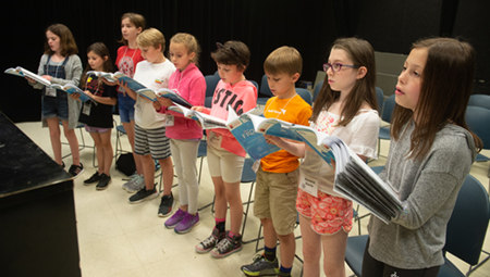 A group of camp participants sing during their voice sectionals.