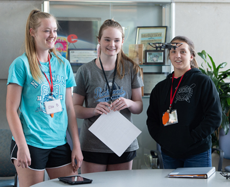 SIUE School of Engineering Summer Camp participants (L-R) Ella Bockhorn, of Waterlook, Hailey Montgomery, of Waterloo, and Avery Rogers, of Effingham, engage in a drone activity.