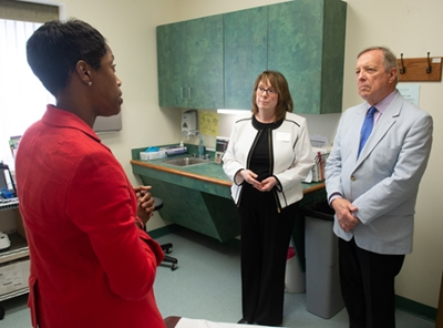 Leading Senator Durbin on a tour of SIUE's WE CARE Clinic were Director Ricki Loar, PhD, APRN, (middle) and Jerrica Ampadu, PhD, (left).