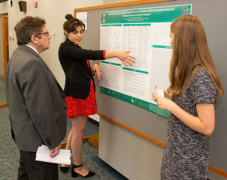 REU participant Laura Ruiz, a senior anthropology major at the University of Tulsa shares her team's findings with SIUE Associate Provost for Research and Dean of the Graduate School Jerry Weinberg, PhD.