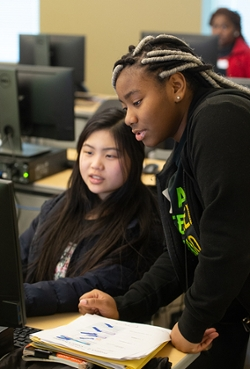 (L-R) Juniors Abby Liu, of Edwardsville, and Nyla Cohen, of Cahokia, work together during SheCode.