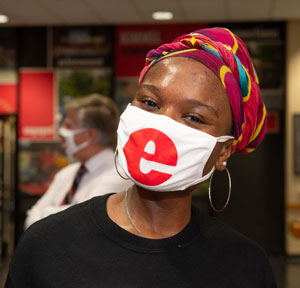 With mask on, continuing senior Jochabay McGeebey's eyes shine as she smiles and engages in a Cougar Welcome activity.