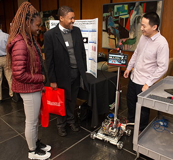 A student showcases his innovative research project to interested attendees at the 2019 Graduate School Research Symposium.