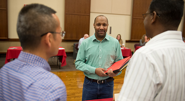 Two students discussing graduate studies at SIUE with an admissions counselor