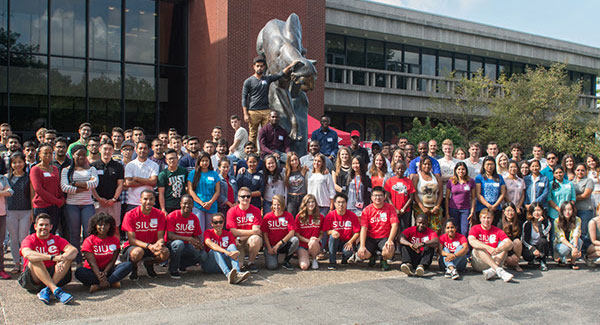 group of graduate students in front of the Cougar Statue