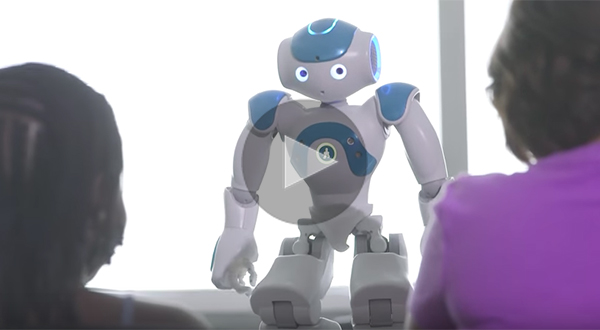 two people watching robot