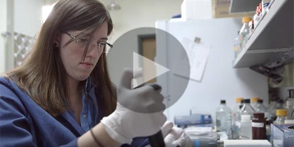 female graduate student in research lab