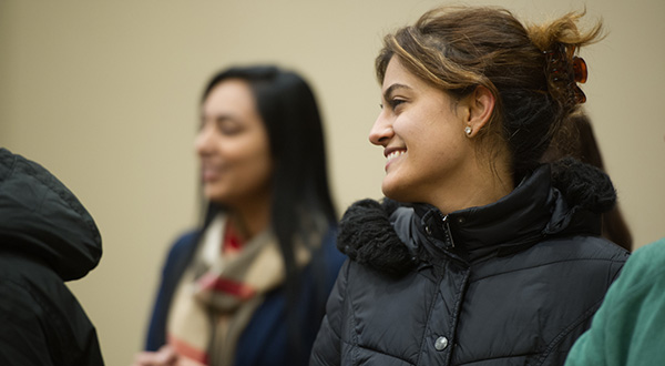 female students smiling and talking