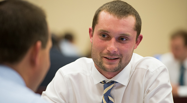 smiling male business students wearing tie